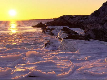Maine's coastline at sunset during the winter