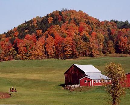 Vermont farm with colored leaves in fall
